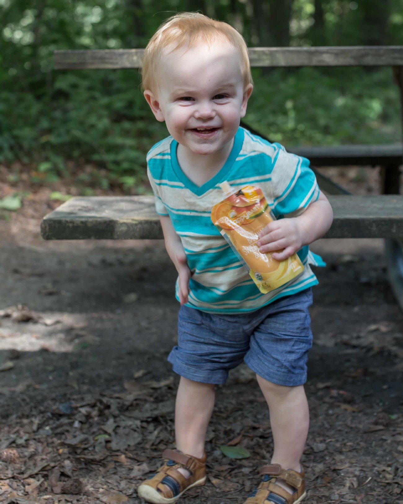 happy toddler with happy baby pouches