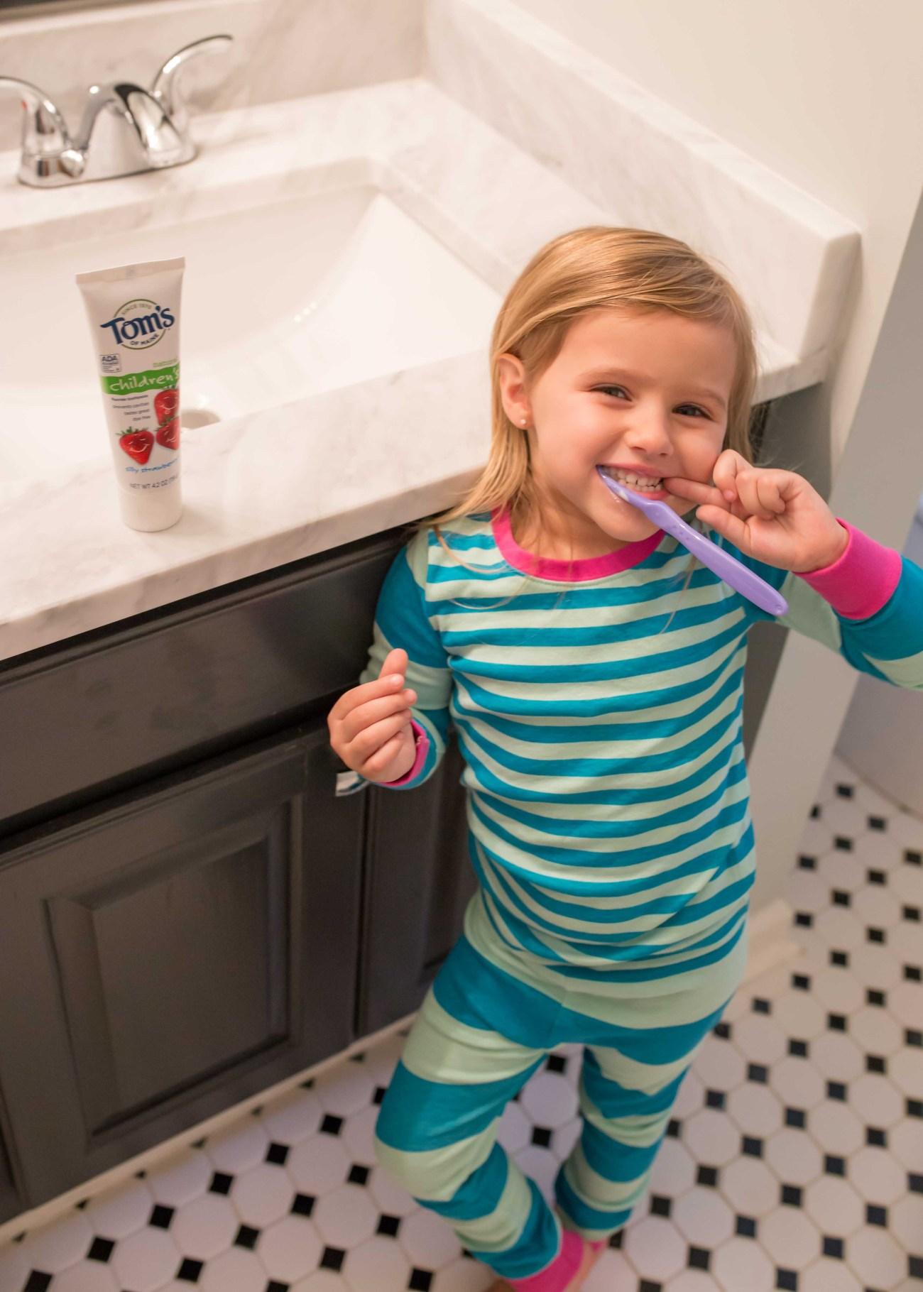 toddler kids brushing teeth