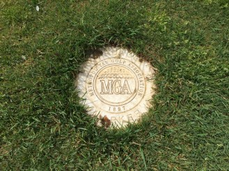 Yardage marker for 150 yards embedded in the fairway.