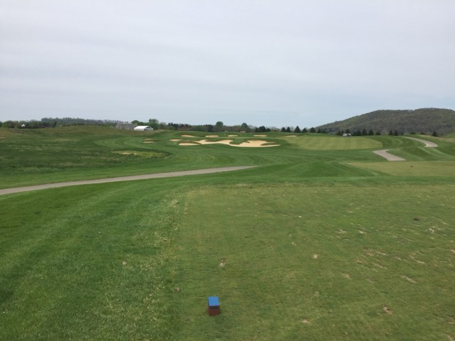 Par 3 17th tee view with bunkers guarding against short and long shots.