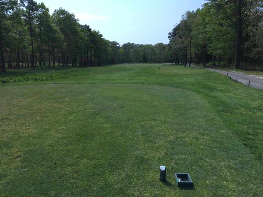 4th tee box with aiming point just left of trap on the right.