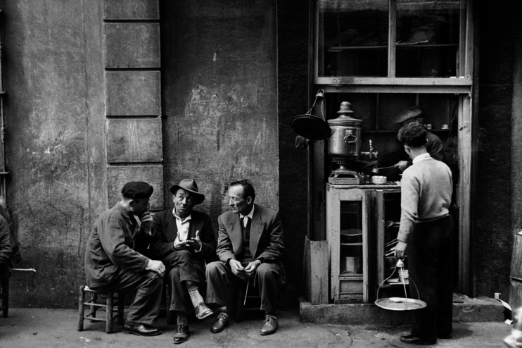TURKEY. People sitting talking beside a coffee bar in a Beyoglu arcade. 1958. Ara Güler / Magnum Photos