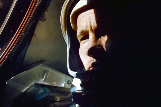 Image Credit NASA s65-30549: Astronaut Edward H. White II, Gemini IV pilot, is photographed gazing out the porthole of the Gemini-Titan IV spacecraft during the four-day Earth-orbital mission, prior to his space walk  on June 3, 1965