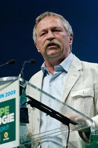 Photograph of Jose Bove speaking at a conference.