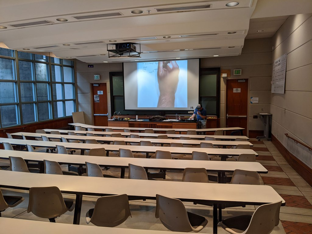 Lecturer Peter Marsden teaches in an empty classroom after COVID-19 shutdown