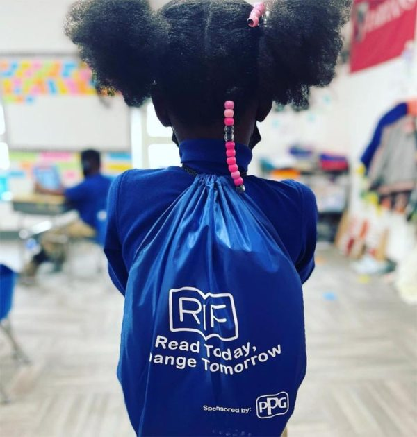 Catalyst Academy scholar with RIF book backpack