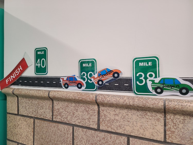 Students' cars on the reading racetrack