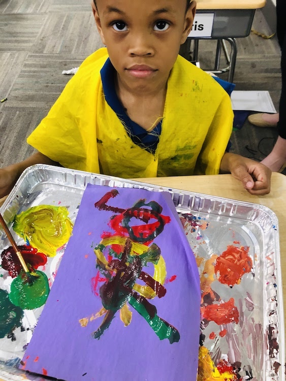 Catalyst scholar showing us his painting tray with a new painting