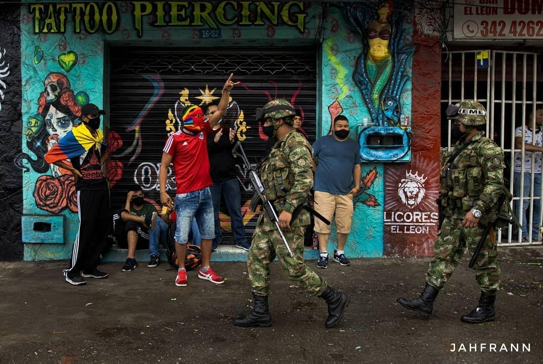 colombians citizens see army on the streets