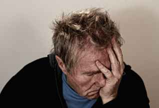 man old depressed headache