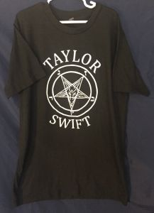Twelve Days of Catmas - Day Thirteen - Taylor Swift and Satan seem pretty close. I've never been to a show but this shirt makes it look pretty rad.