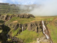Waterfalls tumbling off the edge of the mountain north of Seyðisfjörður, in East Iceland