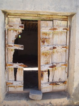 a beaten up entrance in Ibra, Oman