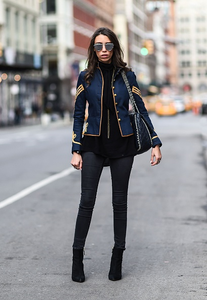 NEW YORK, NY - FEBRUARY 10: Thania Peck is seen on the streets of New York City wearing a Ralph Lauren blue and gold jacket, Paige grey denim jeans, Reiss black leather shoes, Chanel blue leather bag and Gentle Monster sunglasses during New York Fashion Week: Women's Fall/Winter 2016 on February 10, 2016 in New York City. (Photo by Daniel Zuchnik/Getty Images)