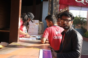 Attendees registering their names