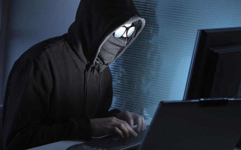 cybercrimes in nepal; a hacker (in the photo)