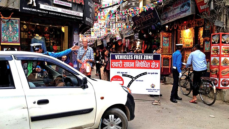 A traffic policeman showing a taxi driver a vehicle-free zone sign for vehicles in Thamel, Kathmandu, on Sunday, October 22, 2017. Photo Credit: The Himalayan Times