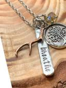 "breathe hand stamped on silver pewter word bar includes hand cast tree charm (plated in sterling silver) and copper antler includes your choice of crystal (amber is shown) includes 30"" silver chain. $32"
