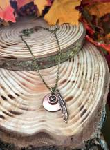 "blank copper disc includes heart charm feather 30"" antiqued brass chain. $30"