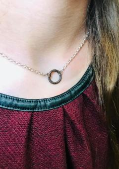 "copper embossed ring necklace includes 16"" silver chain. $28"