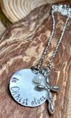 "in Christ alone hand stamped on silver pewter disc includes cross pearl 30""silver chain. $30"