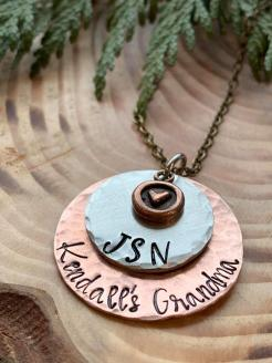 "This piece is hand stamped copper and silver pewter. includes your choice of names/words: up to 16 letters on the copper (larger piece) up to 4 letter on the pewter (smaller piece) copper heart includes with 30"" antiqued brass chain. $40"