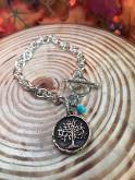 silver toggle bracelet with copper tree of life genuine turquoise bead. $24