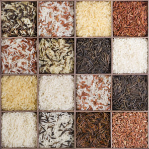 Set of different types of rice in wooden box