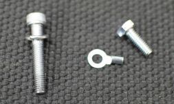 Bolt from earth on LHS of car on left. Bolt on right going in the spare hole.