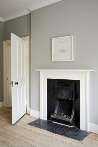 Light grey walls and exposed floorboards