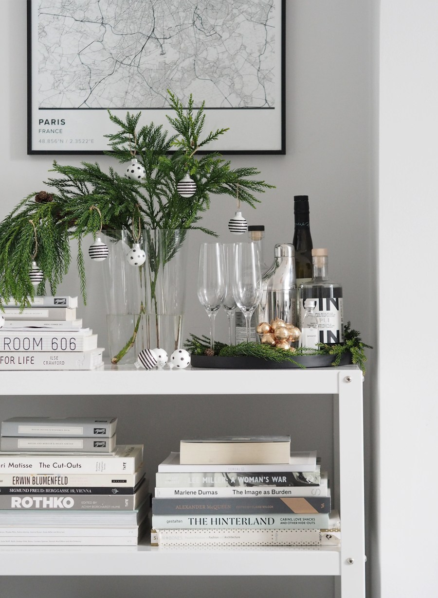 Scandi Christmas. Alternative Christmas tree - a festive branch in a vase with black and white striped baubles. A minimal, monochrome Christmas on a budget with Homesense