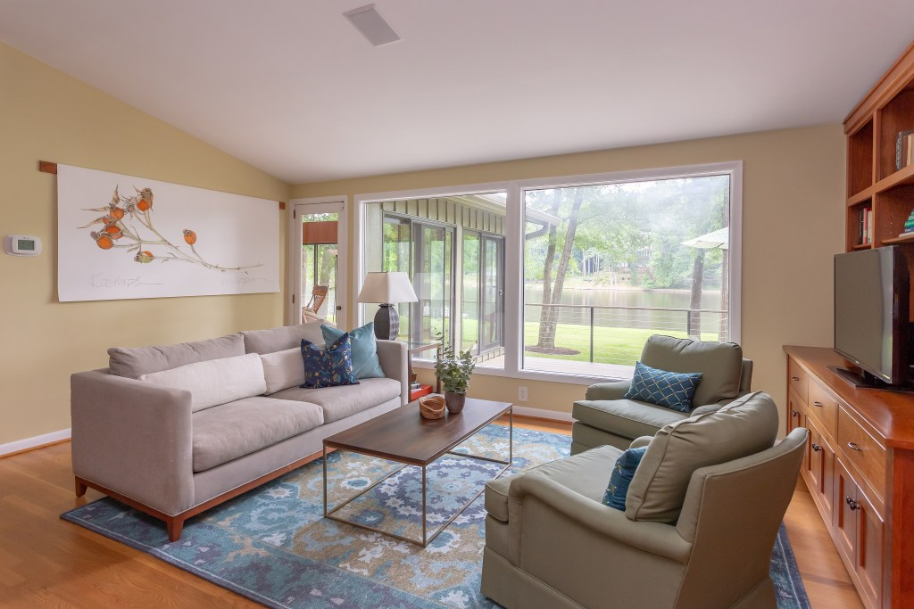 Wonderful lake views from the den with new rug, upholstery and throw pillows.