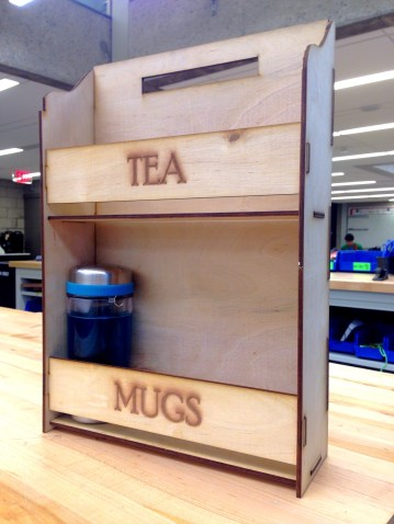 A tea rack I designed for my dorm room. It fits my mugs and standard boxes of tea perfectly, and hangs from the top by two command hooks.