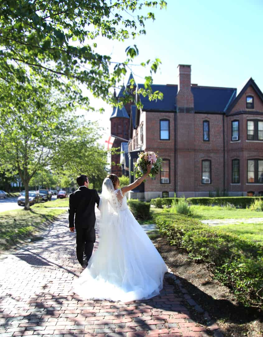 Bride and groom walking away from the church