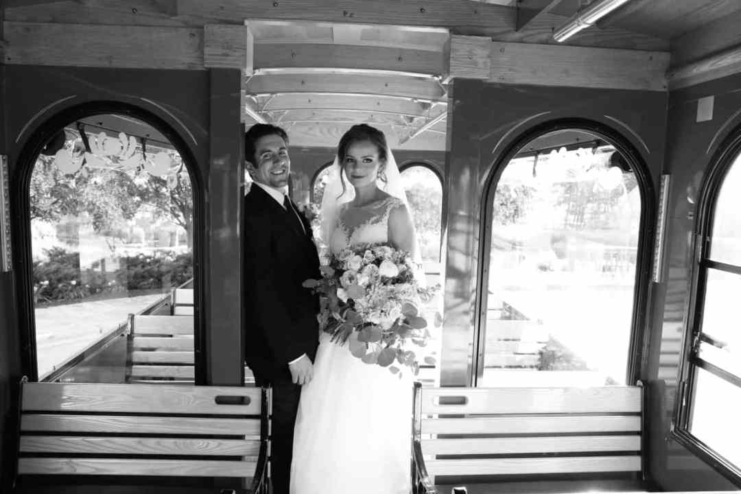 brideand groom on trolley embracing each other, black and white