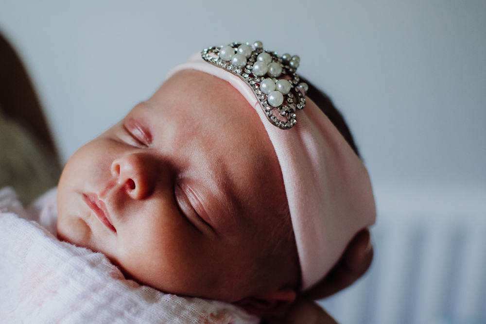 sleeping baby girl with princess tiara headband {san diego lifestyle newborn child family engagement photographer}