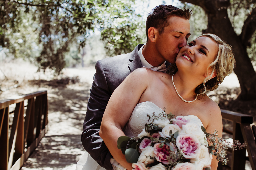 groom kissing brides cheek {virginia beach wedding couples family newborn photographer}