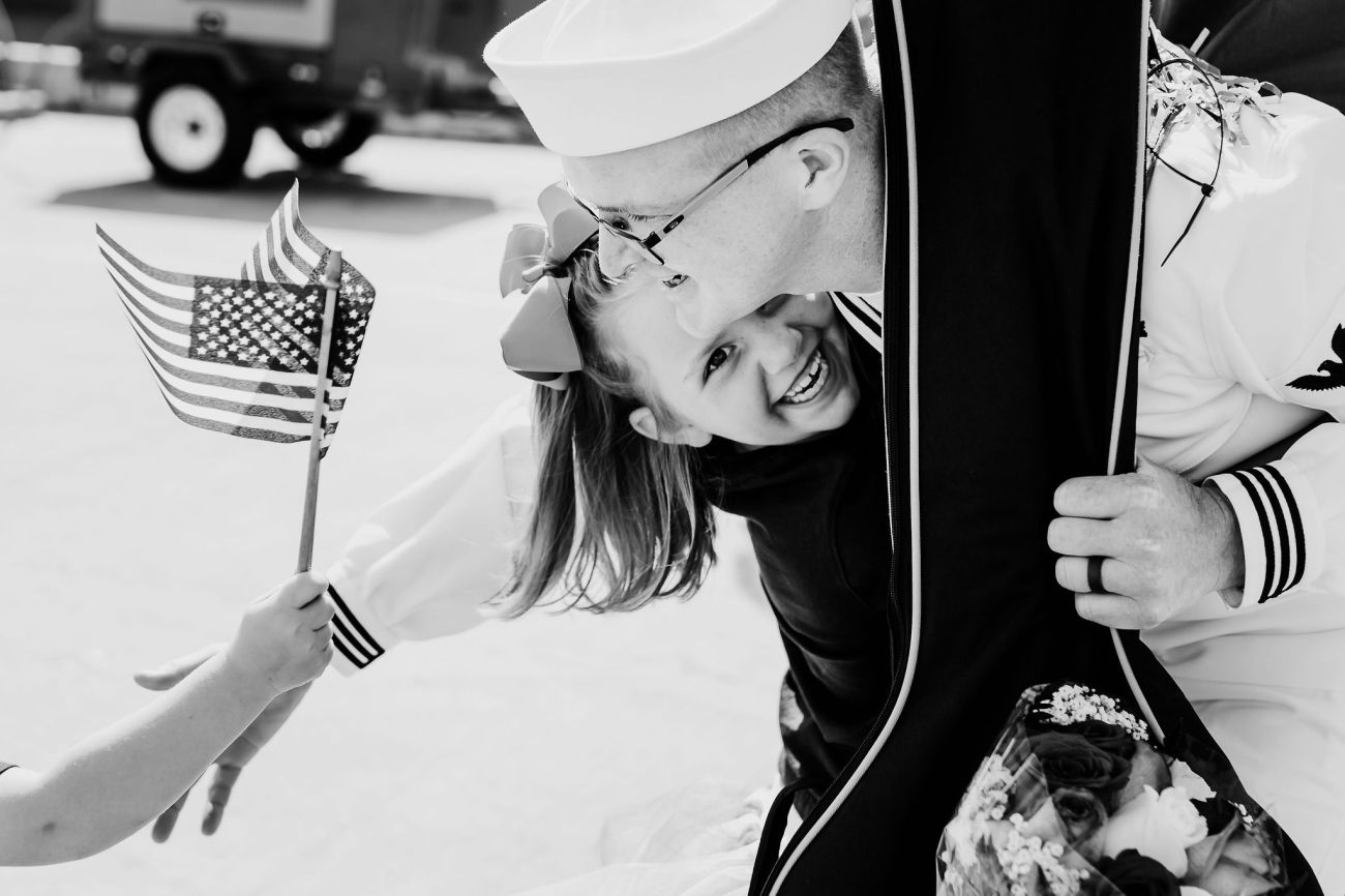 girl running laughing hugging her father san diego navy military homecoming {virginia beach lifestyle newborn child couples family maternity engagement photographer}