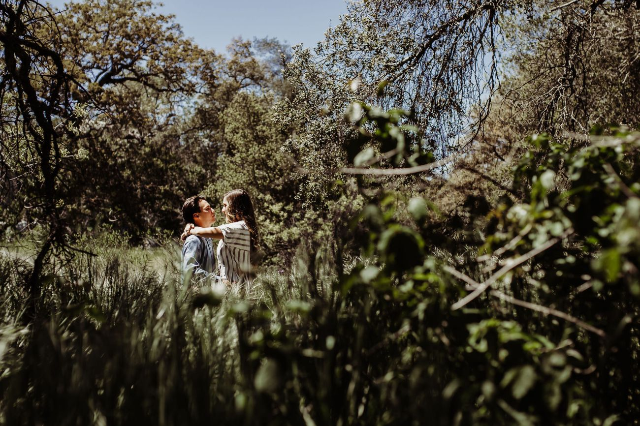 boyfriend girlfriend laughing holding hands walking through hiking trails san diego {virginia beach lifestyle newborn child couples family maternity engagement photographer}