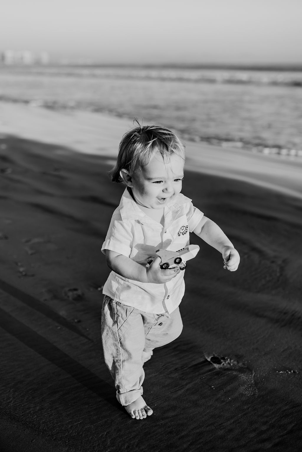 baby boy running on breakers beach coronado {virginia beach chesapeake lifestyle child couples family military homecoming photographer holistic healer transformational mentor}