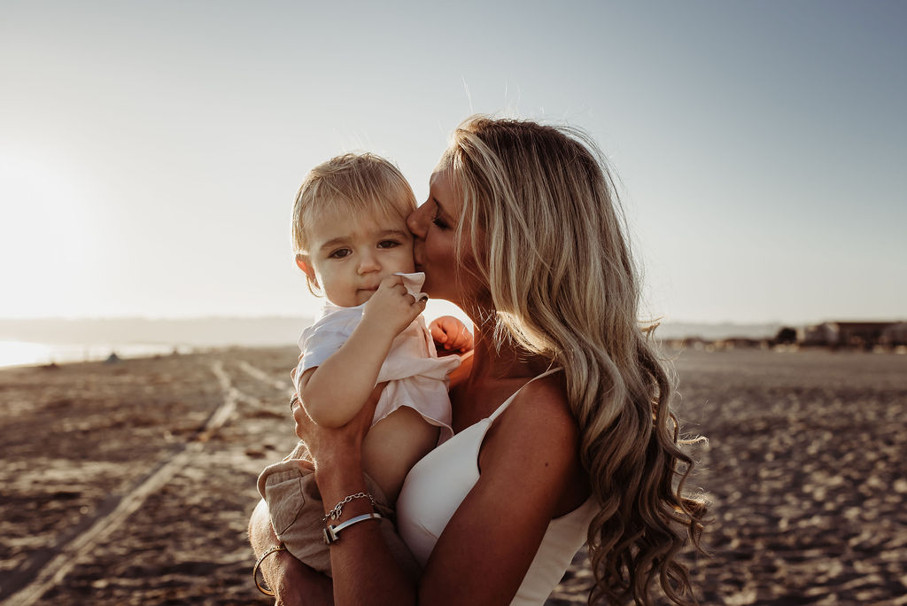 mom kissing baby boy on cheek breakers beach coronado california {virginia beach chesapeake lifestyle child couples family military homecoming photographer holistic healer transformational mentor}