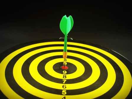 image of dart board with arrow in bullseye
