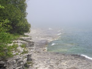 Calmer water over limestone in water