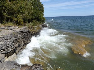 Waves crashing on limestone