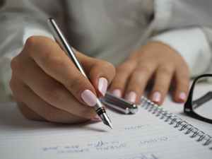 Hand writing a list with a pen