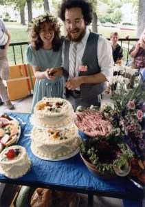 Wedding Couple Laughing with Cake