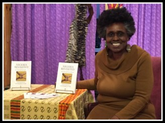 Founder and owner Janifer Wilson with display of memoir
