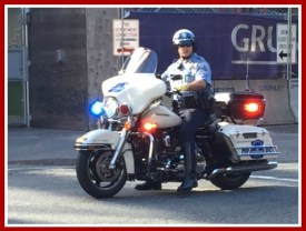 Motorcycle policeman holding back traffic for us