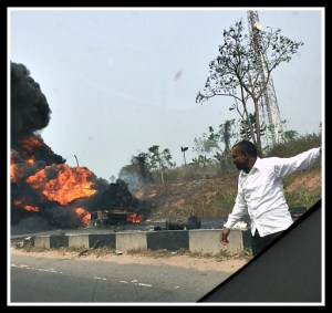 Tanker on fire, being directed by self-appointed traffic director