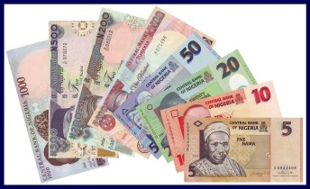 Naira notes, worth less today than a year ago, because of Nigeria's economic woes.
